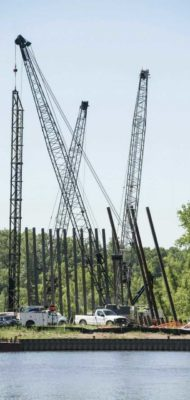 cranes on a construction site used for environmental testing and consulting